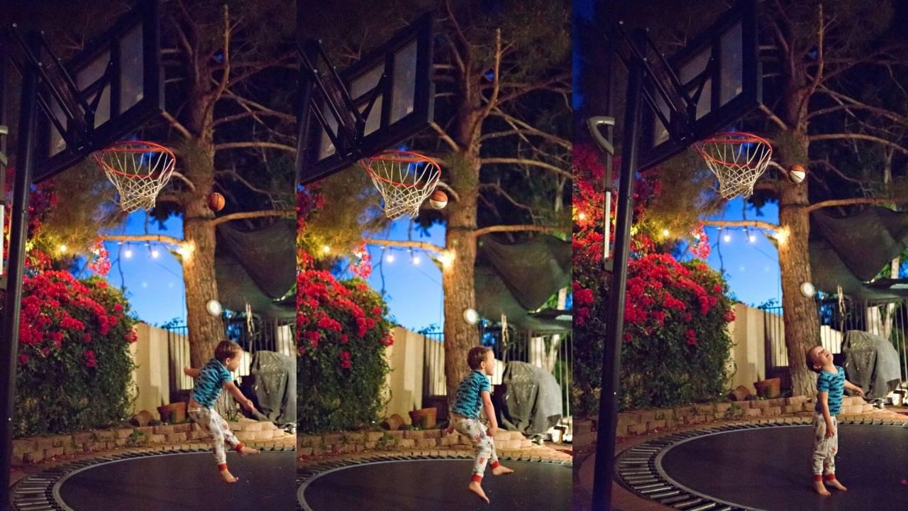 Panier de basket trampoline : petit garçon s'entrainant au tir